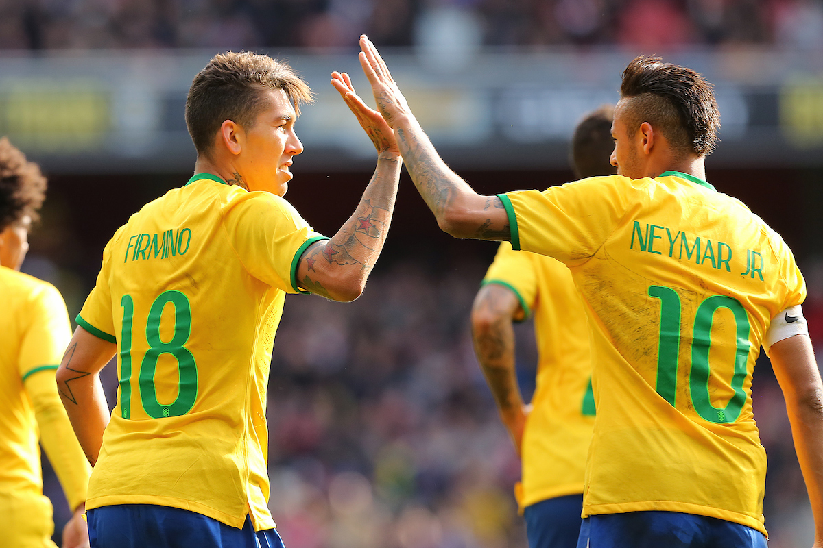 Roberto Firmino of Brazil is congratulated by team mate, Neymar after scoring the only goal in a 1-0 win over Chile in the International Friendly match at the Emirates Stadium, London Picture by Richard Calver/Focus Images Ltd +44 7792 981244 28/03/2015