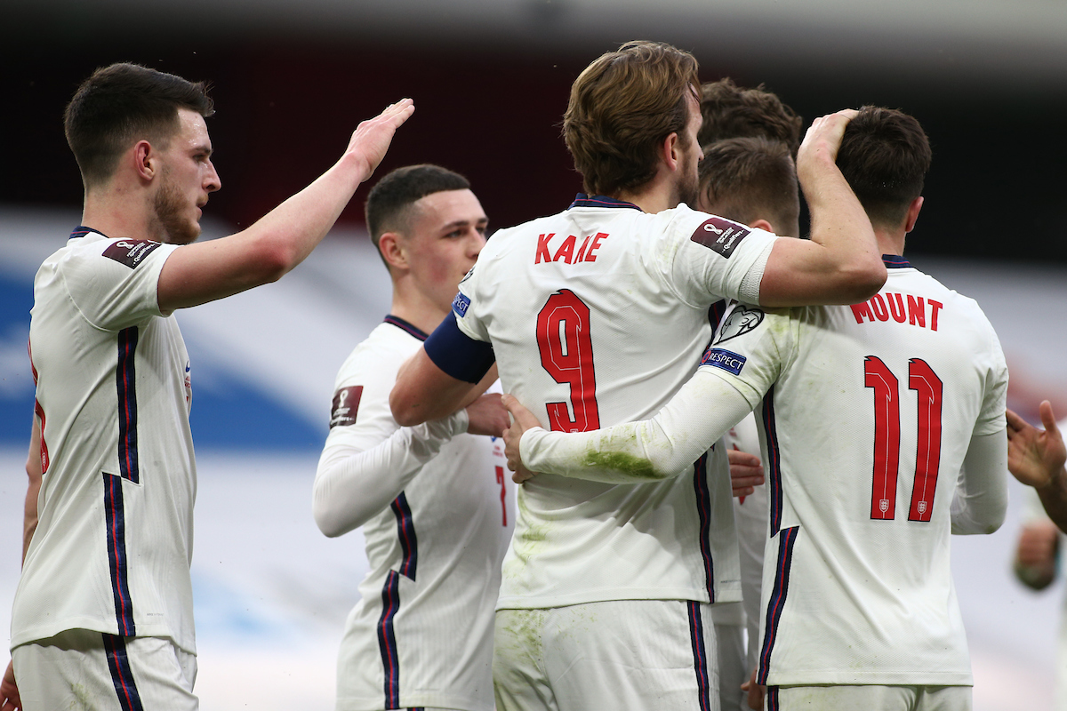 Harry Kane is swamped by his team-mates after scoring for England during the 2022 FIFA World Cup Qualifiers match at the Air Albania Stadium, Tirana Picture by Focus Images/Focus Images Ltd 07813 022858 28/03/2021