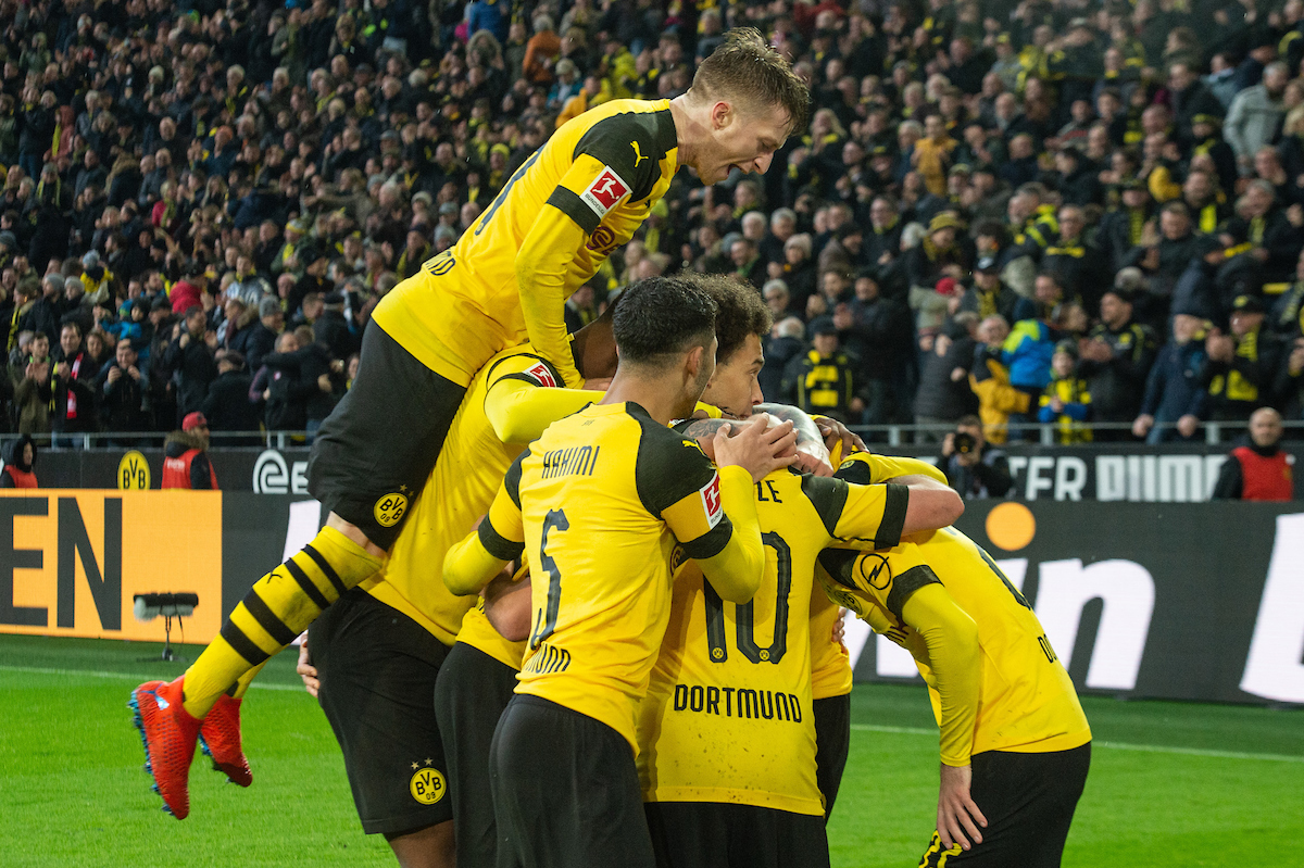 Marco Reus of Borussia Dortmund celebrates with players as they mob Christian Pulisic of Borussia Dortmund after he sores his sides third goal during the Bundesliga match at Signal Iduna Park, Dortmund Picture by Matt Wilkinson/Focus Images Ltd 07814 960751 09/03/2019