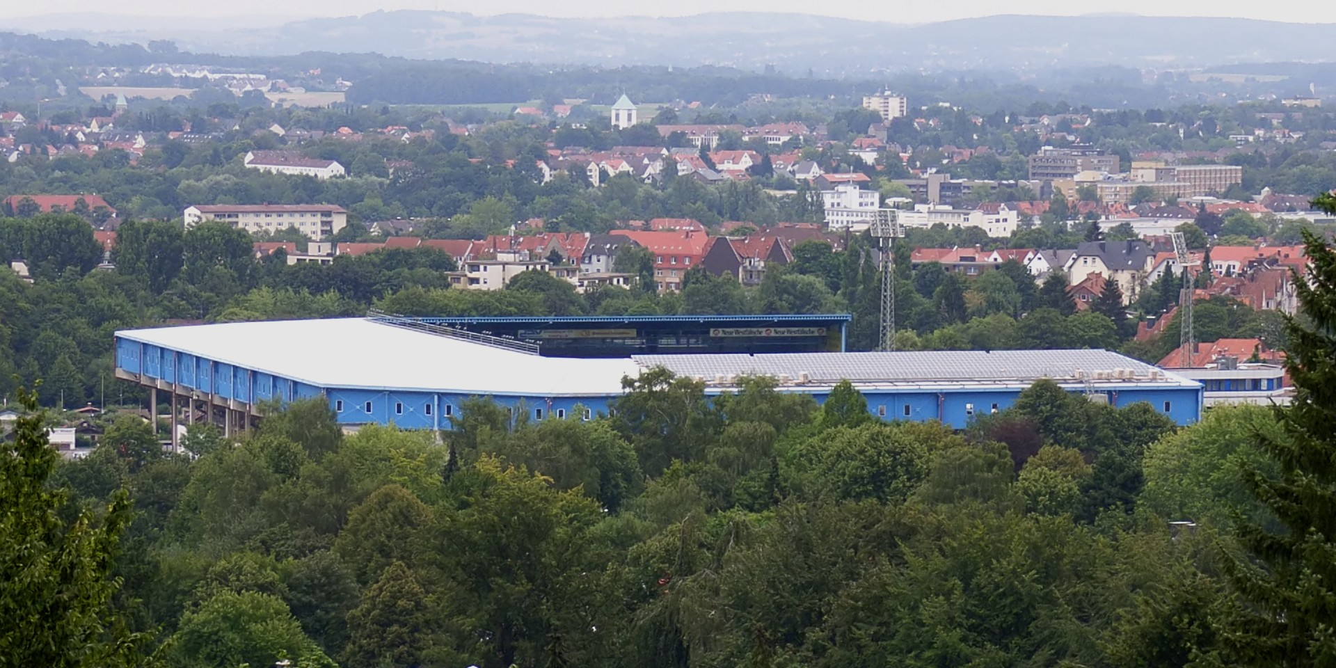 """Bielefeld SchücoArena"" by Zefram - Own work (own photography). Licensed under CC BY 2.0 de via Wikimedia Commons - http://commons.wikimedia.org/wiki/File:Bielefeld_Sch%C3%BCcoArena.jpg#/media/File:Bielefeld_Sch%C3%BCcoArena.jpg Bielefeld_SchücoArena"
