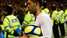 Picture by Andrew Tobin/Focus Images Ltd. 07710 761829.. 07/01/12. Clint Dempsey (23) of Fulham leaves the pitch with the match ball after scoring a hat trick during the FA Cup third round match between Fulham and Charlton Athletic at Craven Cottage stadium, London.