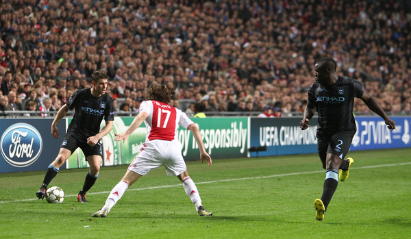 Picture by John  Rainford/Focus Images Ltd +44 7506 538356 24/10/2012 Daley Blind of Ajax Amsterdam and James Milner with Micah Richards of Manchester City during the UEFA Champions League match at Amsterdam Arena, Amsterdam.