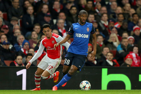 Almamy Toure of AS Monaco FC comes away with the ball despite the attentions of Alexis Sanchez of Arsenal during the UEFA Champions League match at the Emirates Stadium, London Picture by Richard Calver/Focus Images Ltd +447792 981244 25/02/2015