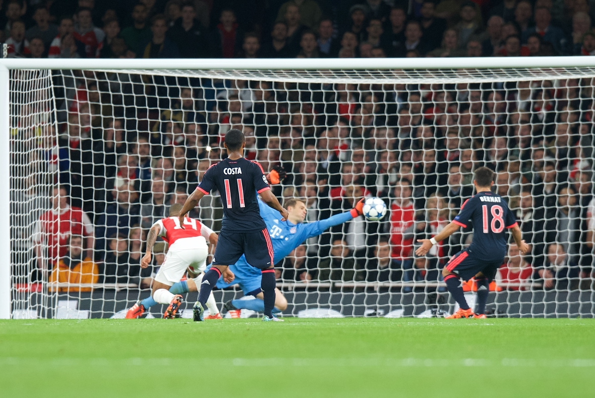 Goalkeeper Manuel Neuer of Bayern Munich gets his fingertips to a shot from Theo Walcott (14) of Arsenal to keep the score 0-0 during the UEFA Champions League match at the Emirates Stadium, London Picture by Alan Stanford/Focus Images Ltd +44 7915 056117 20/10/2015
