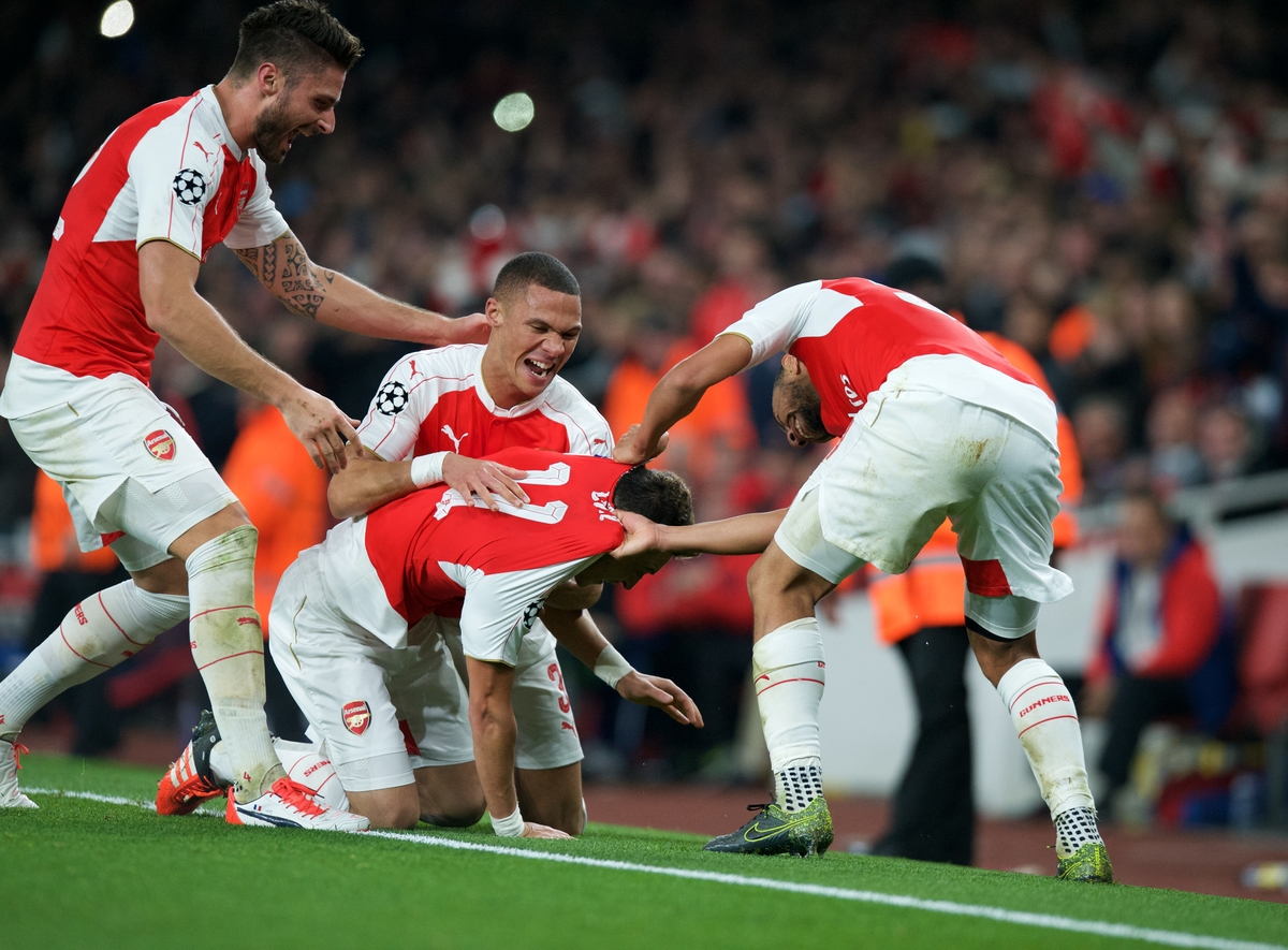 Mesut Ozil (11) of Arsenal of Arsenal celebrates after scoring their second goal with his team mates during the UEFA Champions League match at the Emirates Stadium, London Picture by Alan Stanford/Focus Images Ltd +44 7915 056117 20/10/2015
