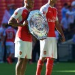 Alex Oxlade-chamberlain (left) of Arsenal and Kieran Gibbs hold the Charity Shield after defeating Chelsea 1-0 after the FA Community Shield match at Wembley Stadium, London Picture by Alan Stanford/Focus Images Ltd +44 7915 056117 02/08/2015
