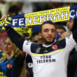 Picture by Paul Terry/Focus Images Ltd +44 7545 642257 27/08/2013 Fenerbahce fans hold up a scarf during the UEFA Champions League match at the Emirates Stadium, London.