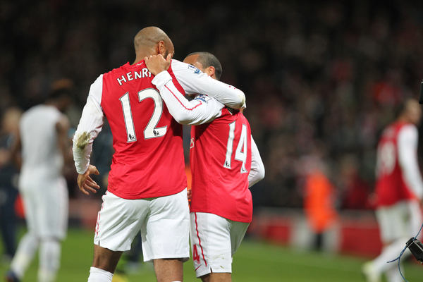 Picture by Paul Terry/Focus Images Ltd. 07545642257.09/01/12.Thierry Henry of Arsenal celebrates with Theo Walcott after the teams win during the FA Cup third round match at Emirates Stadium, London.
