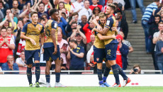 Aaron Ramsey of Arsenal (2nd right) celebrates with Olivier Giroud of Arsenal (right) after he scores his team's fourth goal against Olympique Lyonnais to make it 4-0 during the Emirates Cup match at the Emirates Stadium, London Picture by David Horn/Focus Images Ltd +44 7545 970036 25/07/2015