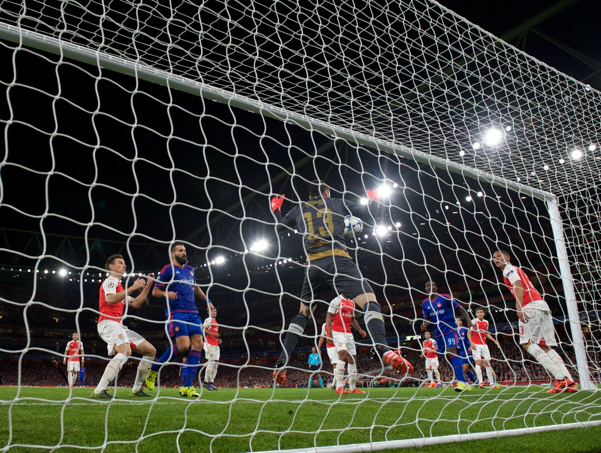 Goalkeeper David Ospina of Arsenal fumbles a shot from Kostas Fortounis of Olympiakos (out of shot) to concede a second goal during the UEFA Champions League match at the Emirates Stadium, London Picture by Alan Stanford/Focus Images Ltd +44 7915 056117 29/09/2015
