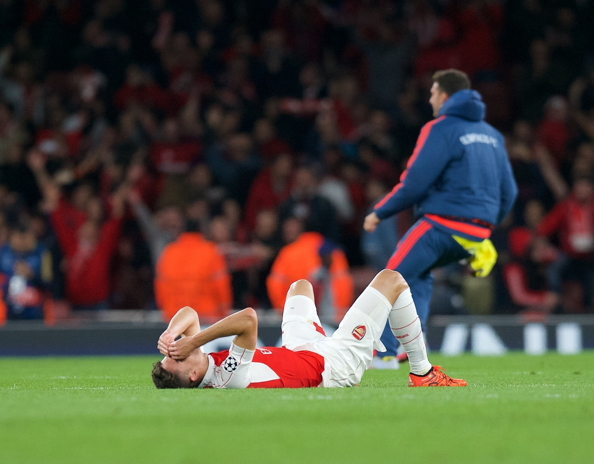 Gabriel Paulista of Arsenal looks dejected after the are beaten 3-2 by Olympiakos during the UEFA Champions League match at the Emirates Stadium, London Picture by Alan Stanford/Focus Images Ltd +44 7915 056117 29/09/2015