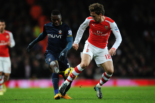 Emmanuel Mayuka of Southampton does battle with Nacho Monreal of Arsenal during the Barclays Premier League match between Arsenal and Southampton at the Emirates Stadium, London Picture by Richard Blaxall/Focus Images Ltd +44 7853 364624 03/12/2014