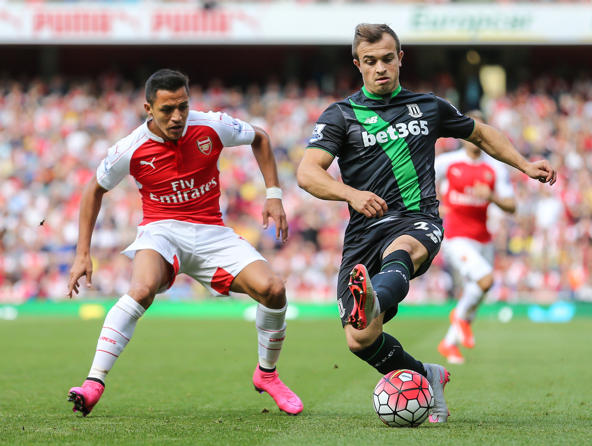 Alexis Sanchez of Arsenal (left) chases down Xherdan Shaqiri of Stoke City during the Barclays Premier League match at the Emirates Stadium, London Picture by David Horn/Focus Images Ltd +44 7545 970036 12/09/2015