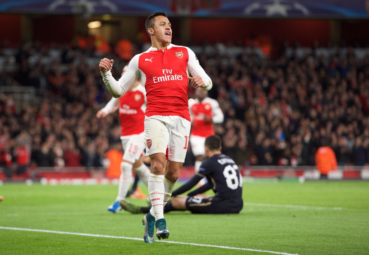 Alexis Sanchez of Arsenal celebrates after scoring his side's 2nd goal during the UEFA Champions League match at the Emirates Stadium, London Picture by Alan Stanford/Focus Images Ltd +44 7915 056117 24/11/2015