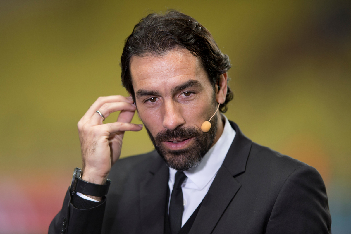Former Arsenal player Robert Pires prepares to give a TV interview ahead of the UEFA Champions League round of 16 second leg at Stade Louis II, Monaco Picture by Russell Hart/Focus Images Ltd 07791 688 420 17/03/2015
