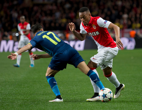 Anthony Martial of Monaco turns outside Alexis Sanchez of Arsenal during the UEFA Champions League round of 16 second leg at Stade Louis II, Monaco Picture by Russell Hart/Focus Images Ltd 07791 688 420 17/03/2015