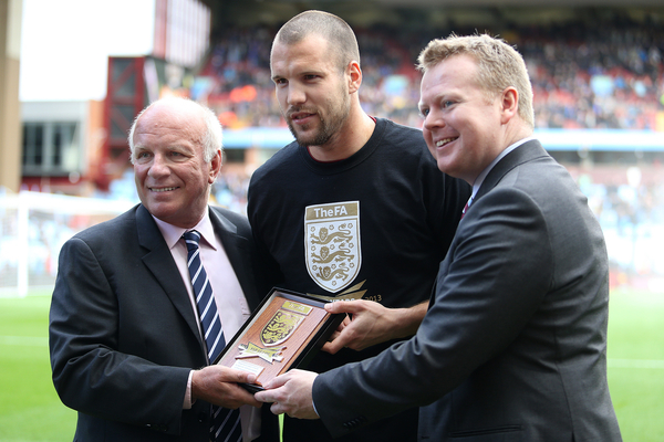 Football Association chairman Greg Dyke (left) presented a special commemorative plaque to Ron Vlaar, Aston Villa Captain as part of the FA's 150th anniversary celebrations as the most-played fixture in English football before the Barclays Premier League match between Aston Villa and Everton at Villa Park, Birmingham.