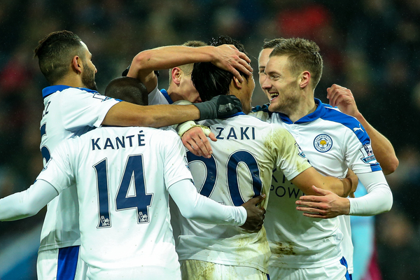 Jamie Vardy of Leicester City (right) congratulates Shinji Okazaki of Leicester City (centre) on scoring their first goal during the Barclays Premier League match at Villa Park, Birmingham Picture by Andy Kearns/Focus Images Ltd 0781 864 4264 16/01/2016