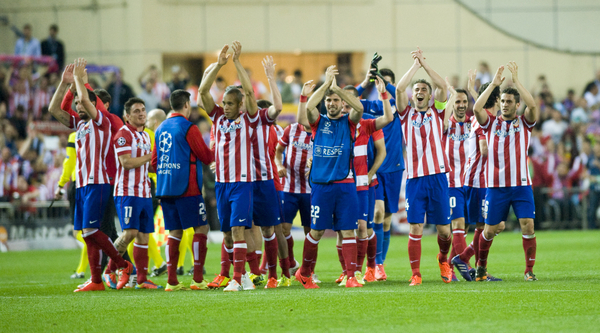 players of Athletico Madrid celebrating the victory during the UEFA Champions League match at Vicente Calderón Stadium, Madrid Picture by Marcos Calvo Mesa/Focus Images Ltd +34 654142934 09/04/2014