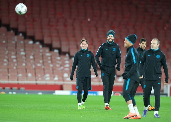 Lionel Messi (left) and Gerard Pique during the Barcelona training session at the Emirates Stadium, prior to their Champions League match against Arsenal tomorrow. London, England. Picture by Alan Stanford/Focus Images Ltd +44 7915 056117 22/02/2016