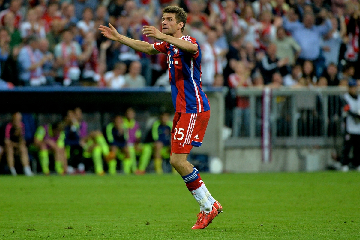 Thomas Müller of Bayern Munich celebrates scoring their third goal to make it Bayern Munich 3 FC Barcelona 2 during the UEFA Champions League semi-final match at Allianz Arena, Munich Picture by Ian Wadkins/Focus Images Ltd +44 7877 568959 12/05/2015