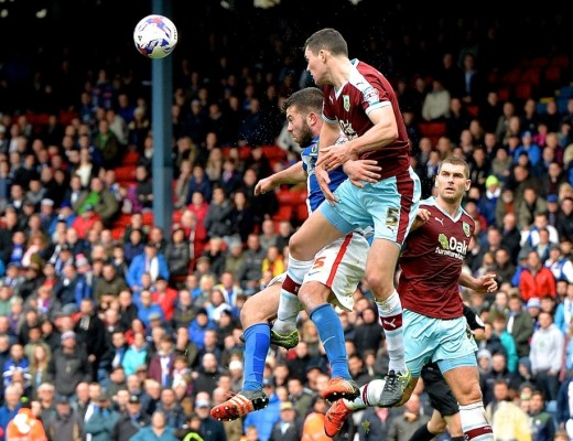Michael Keane of Burnley (2nd left) heads clear under pressure from Grant Hanley of Blackburn Rovers during the Sky Bet Championship match at Ewood Park, Blackburn Picture by Ian Wadkins/Focus Images Ltd +44 7877 568959 24/10/2015
