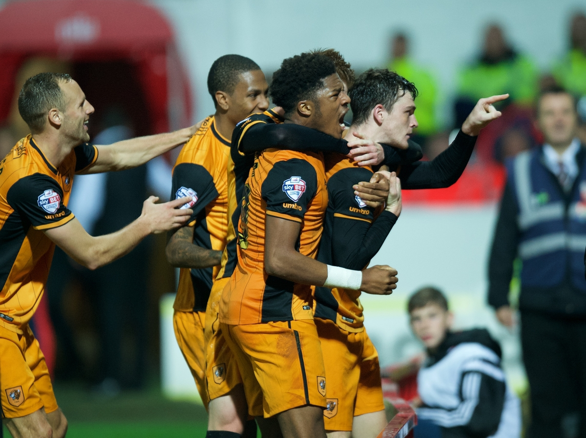 Andrew Robertson (right) of Hull City celebrates with his team mates after scoring the opening goal during the Sky Bet Championship match at Griffin Park, London Picture by Alan Stanford/Focus Images Ltd +44 7915 056117 03/11/2015