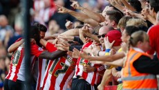 Brentford players celebrate their second goal with the fans during the Sky Bet Championship match between Brentford and Preston North End at Griffin Park, London Picture by Mark D Fuller/Focus Images Ltd +44 7774 216216 19/09/2015