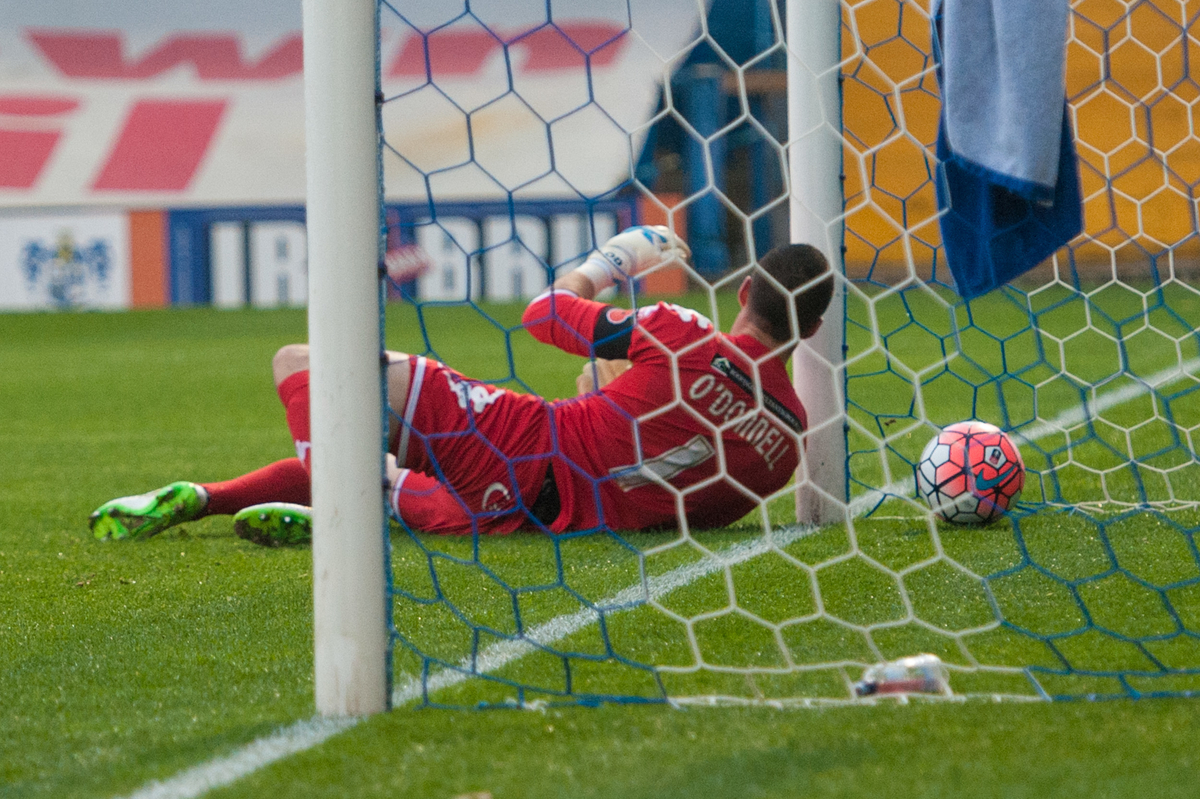 Richard O'Donnell of Wigan Athletic fumbles the ball in to his own net for the opening goal during the FA Cup match at Gigg Lane, Bury Picture by Matt Wilkinson/Focus Images Ltd 07814 960751 07/11/2015