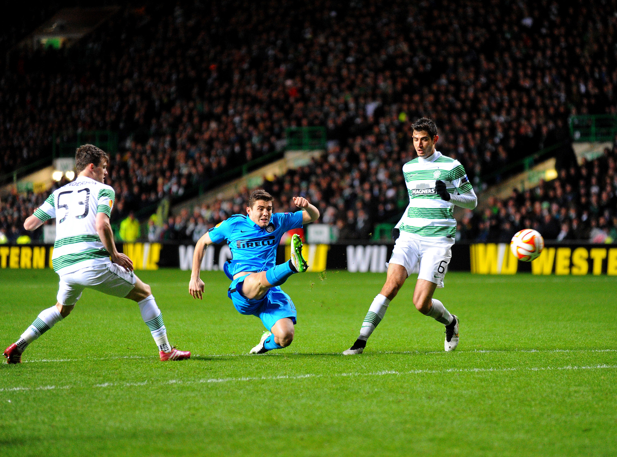 Mateo Kovacic of Inter Milan (centre) shoots but misses a chance during the UEFA Europa League match at Celtic Park, Glasgow Picture by Greg Kwasnik/Focus Images Ltd +44 7902 021456 19/02/2015