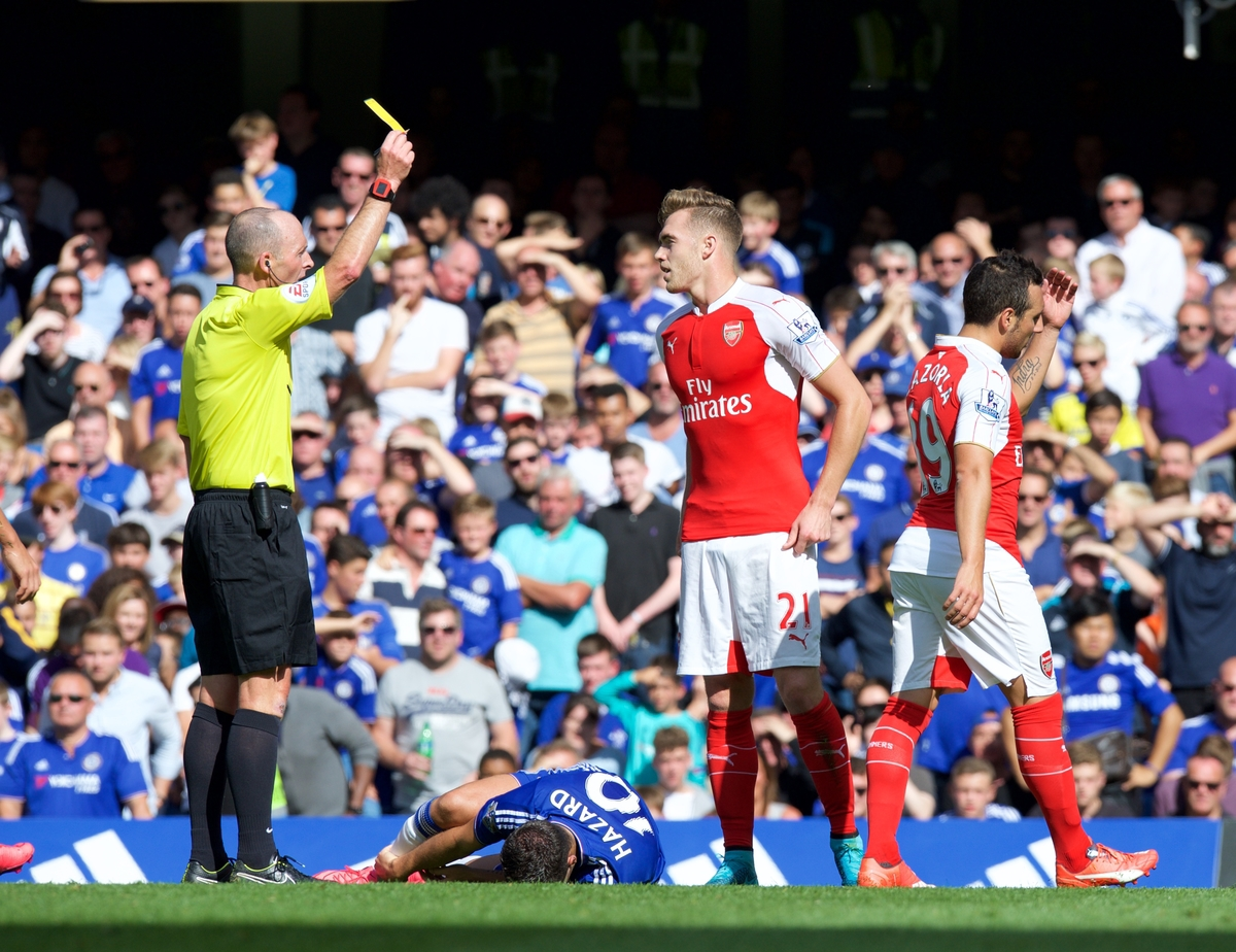Calum Chambers of Arsenal is shown the yellow card by referee Mike Dean for a foul on Eden Hazard of Chelsea during the Barclays Premier League match at Stamford Bridge, London Picture by Alan Stanford/Focus Images Ltd +44 7915 056117 19/09/2015