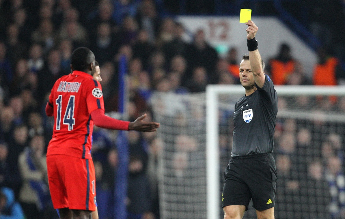 Referee, Bjorn Kuipers shows Blaise Matuidi of Paris Saint-Germain a yellow card for a challenge on Eden Hazard ( not pictured ) of Chelsea during the UEFA Champions League match at Stamford Bridge, London Picture by Paul Terry/Focus Images Ltd +44 7545 642257 11/03/2015