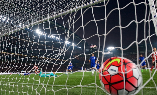 Graziano Pelle (left) of Southampton scores his side's 3rd goal to make it 1-3 drilling the ball past goalkeeper Asmir Begovic of Chelsea during the Barclays Premier League match at Stamford Bridge, London Picture by Alan Stanford/Focus Images Ltd +44 7915 056117 03/10/2015