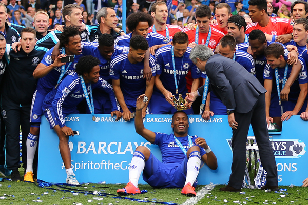 Manager of Chelsea, Jose Mourinho places the crown of the trophy onto the head of Didier Drogba of Chelsea after the Barclays Premier League match at Stamford Bridge, London Picture by Richard Calver/Focus Images Ltd +44 7792 981244 24/05/2015