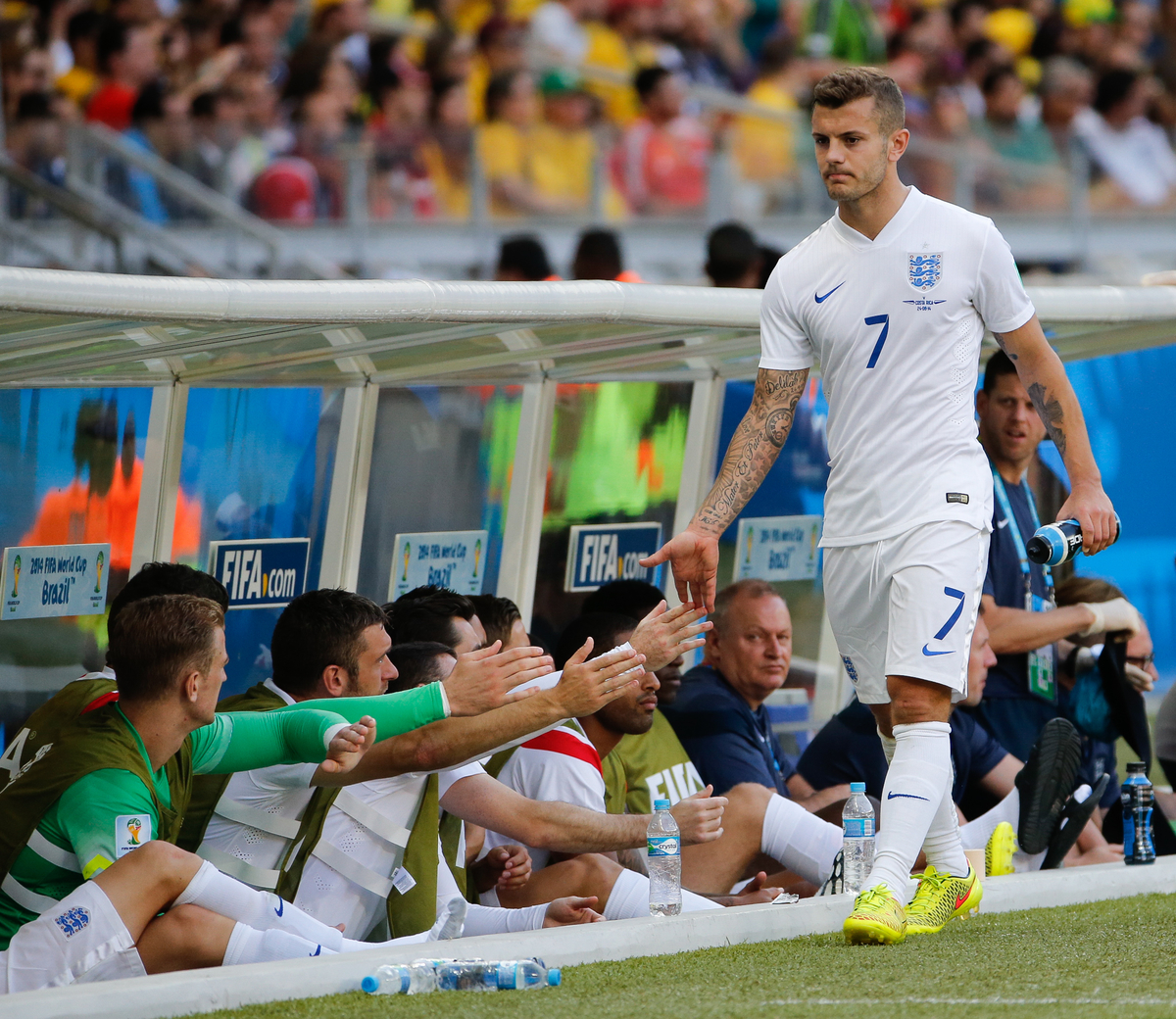 Jack Wilshere of England looks unhappy as he is substituted and shakes hands with his team mates on the bench during the 2014 FIFA World Cup match at Mineirao, Belo Horizonte, Brazil.  Picture by Andrew Tobin/Focus Images Ltd +44 7710 761829 24/06/2014