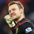 Goalkeeper Simon Mignolet of Liverpool  celebrates their win after the FA Cup match at Selhurst Park, London Picture by Alan Stanford/Focus Images Ltd +44 7915 056117 14/02/2015