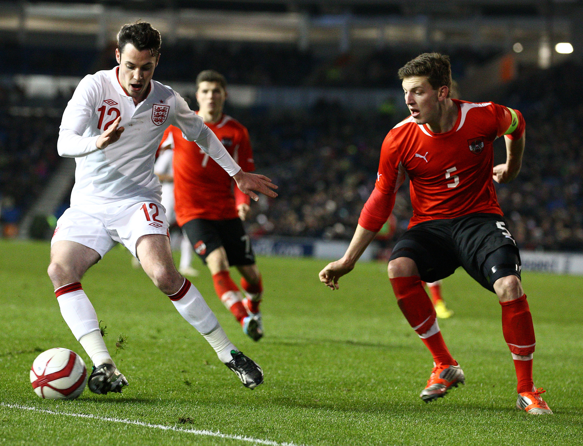 Picture by Paul Terry/Focus Images Ltd +44 7545 642257.25/03/2013.Adam Smith ( L ) of England and Kevin Wimmer of Austria in action during the International Friendly match at the American Express Community Stadium, Brighton and Hove.