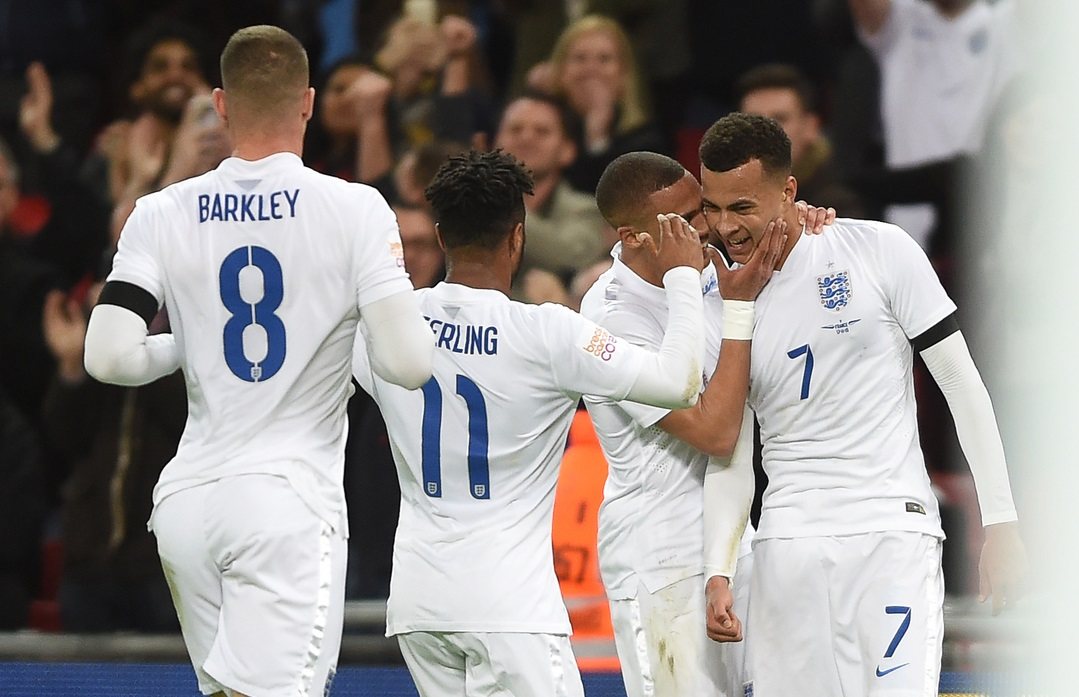 Dele Alli of England (far right) celebrates his goal with team mates during the Breast Cancer Care International Friendly match at Wembley Stadium, London Picture by Daniel Hambury/Focus Images Ltd +44 7813 022858 17/11/2015
