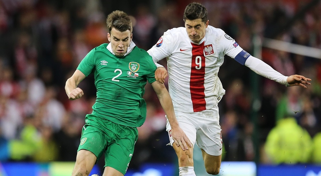 Seamus Coleman of Republic of Ireland and Robert Lewandowski of Poland during the UEFA Euro 2016 Qualifying match at the Aviva Stadium, Dublin Picture by Lorraine O'Sullivan/Focus Images Ltd +353 872341584 29/03/2015