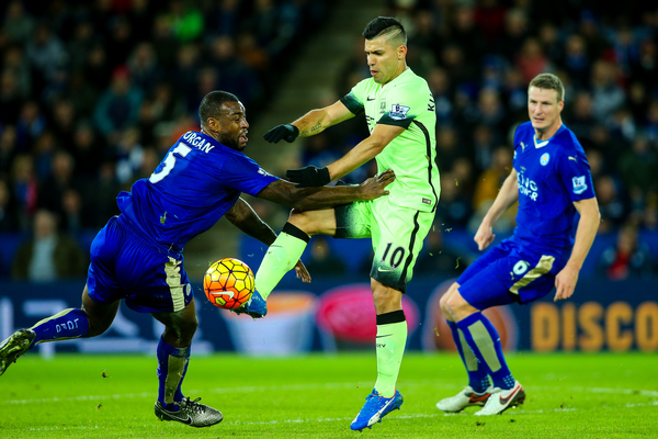 Sergio Aguero of Manchester City (centre) competing with Wes Morgan of Leicester City (left) during the Barclays Premier League match at the King Power Stadium, Leicester Picture by Andy Kearns/Focus Images Ltd 0781 864 4264 29/12/2015