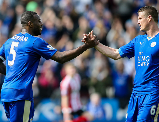Wes Morgan of Leicester City (left) is congratulated on scoring by Robert Huth of Leicester City (right) during the Barclays Premier League match at the King Power Stadium, Leicester Picture by Andy Kearns/Focus Images Ltd 0781 864 4264 03/04/2016