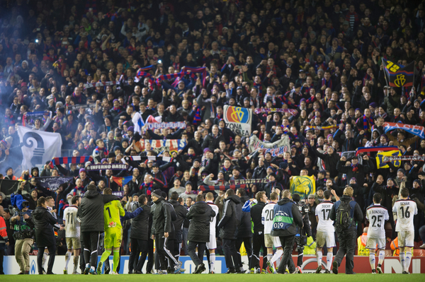 FC Basel players and staff celebrate with their fans following the UEFA Champions League match at Anfield, Liverpool Picture by Russell Hart/Focus Images Ltd 07791 688 420 09/12/2014