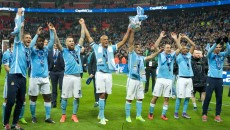 (left to right) Martin Demichelis, Wilfried Bony, Nicolas Otamendi, Vincent Kompany, Sergio Aguero, Pablo Zabaleta and Fernandinho of Manchester City celebrate with the trophy during the Capital One Cup Final at Wembley Stadium, London Picture by Alan Stanford/Focus Images Ltd +44 7915 056117 28/02/2016