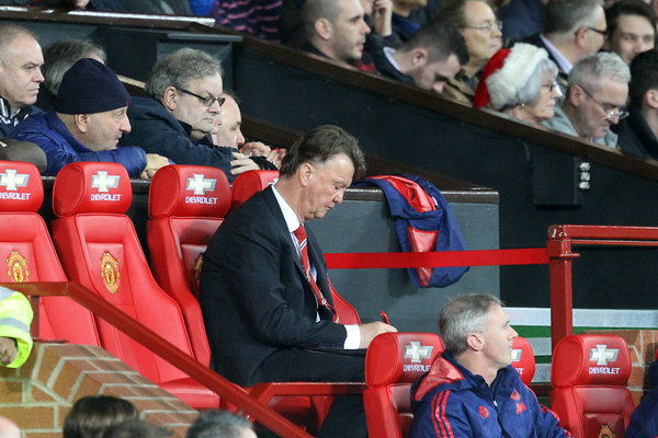 A home fan looks over his shoulder as Manchester United Manager Louis van Gaal makes notes during the Barclays Premier League match at Old Trafford, Manchester Picture by Paul Chesterton/Focus Images Ltd +44 7904 640267 19/12/2015
