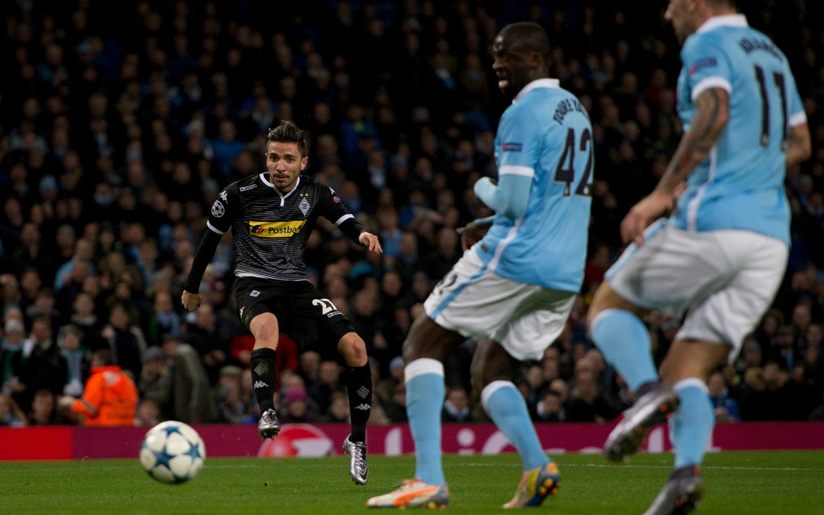Julian Korb of Borussia Monchengladbach (left) scores his team's equalising goal to make it 1-1 during the UEFA Champions League match at the Etihad Stadium, Manchester Picture by Russell Hart/Focus Images Ltd 07791 688 420 08/12/2015