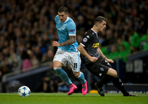Aleksandar Kolarov of Manchester City (left) side-steps Nico Elvedi of Borussia Monchengladbach during the UEFA Champions League match at the Etihad Stadium, Manchester Picture by Russell Hart/Focus Images Ltd 07791 688 420 08/12/2015