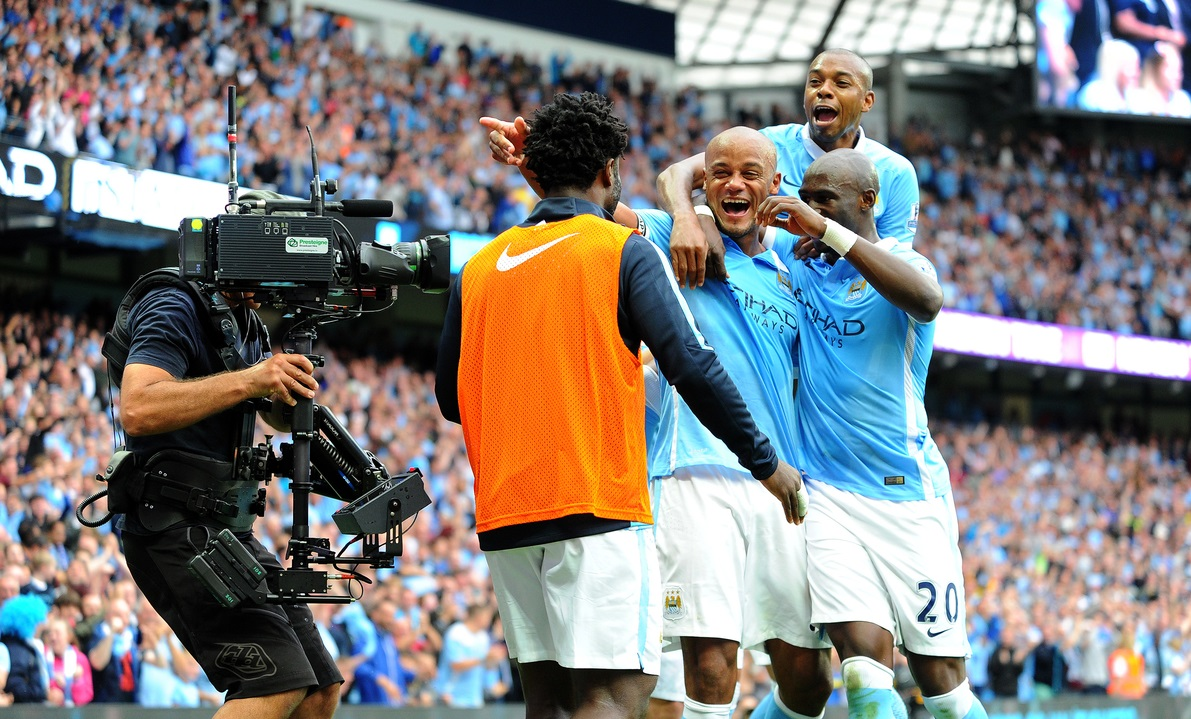 Manchester City players celebrate after Vincent Kompany (third right) scored their second goal during the Barclays Premier League match at the Etihad Stadium, Manchester Picture by Greg Kwasnik/Focus Images Ltd +44 7902 021456 16/08/2015