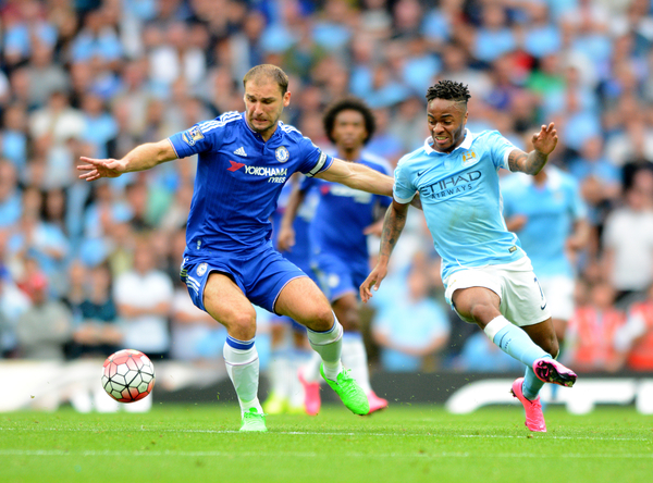 Branislav Ivanovic of Chelsea (left) battles with Raheem Sterling of Manchester City during the Barclays Premier League match at the Etihad Stadium, Manchester Picture by Greg Kwasnik/Focus Images Ltd +44 7902 021456 16/08/2015