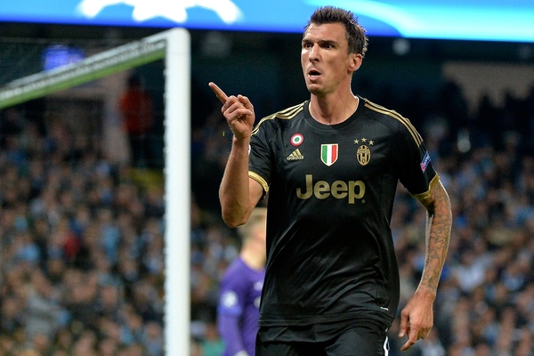 Mario Mandžuki? of Juventus celebrates scoring their first goal to make it Manchester City 1 Juventus 1 during the UEFA Champions League match at the Etihad Stadium, Manchester Picture by Ian Wadkins/Focus Images Ltd +44 7877 568959 15/09/2015