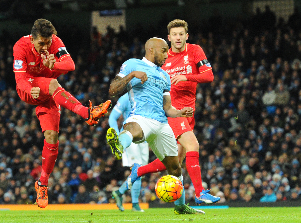 Roberto Firmino of Liverpool (left) shoots at goal but has his shot saved by Manchester City goalkeeper Joe Hart (not pictured here) during the Barclays Premier League match at the Etihad Stadium, Manchester Picture by Greg Kwasnik/Focus Images Ltd +44 7902 021456 21/11/2015